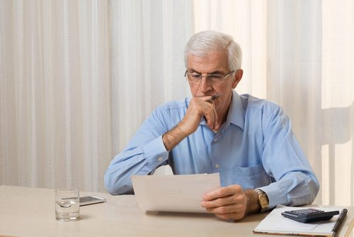 Senior man reviewing document